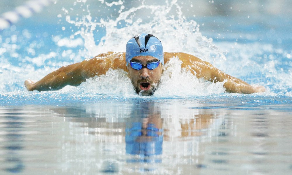 Jan 15, 2016; Austin, TX, USA; Michael Phelps competes in the Final of the 100m Butterfly during the 2016 Arena Pro Swim Series at Lee & Joe Jamail Texas Swimming Center. Mandatory Credit: Soobum Im-USA TODAY Sports